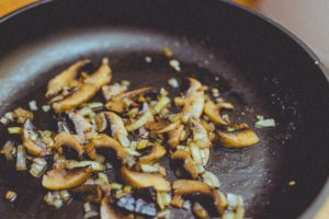 Mushrooms sauteed in a skillet