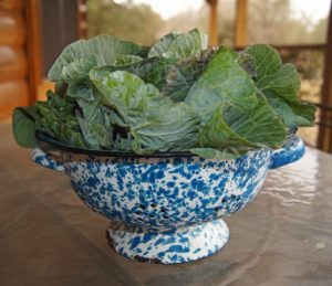 Collard greens in a blue and white patterned bowl