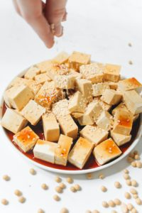 Cubed tofu with marinade and sesame seeds