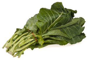 Collard greens tied together in a bunch with a red tie.